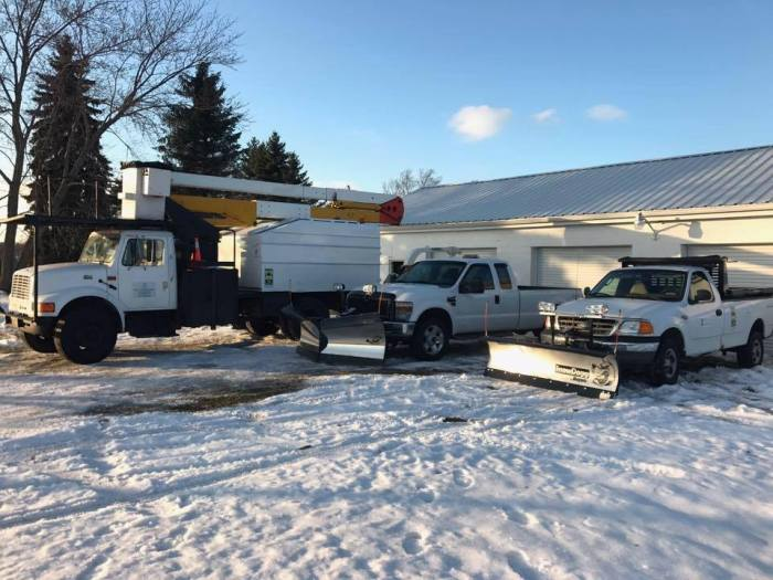 snow removal trucks at shop